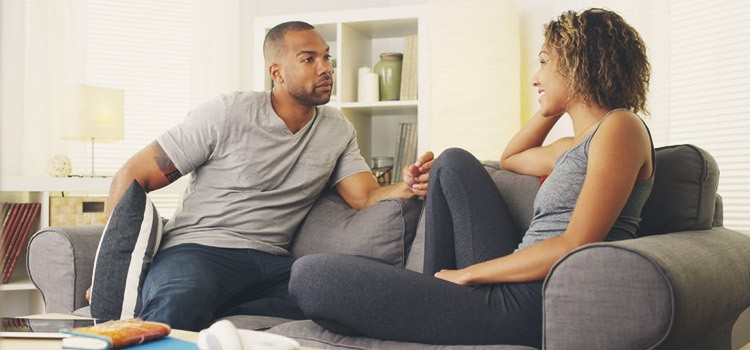 Picture of couple in conversation - sti symptoms